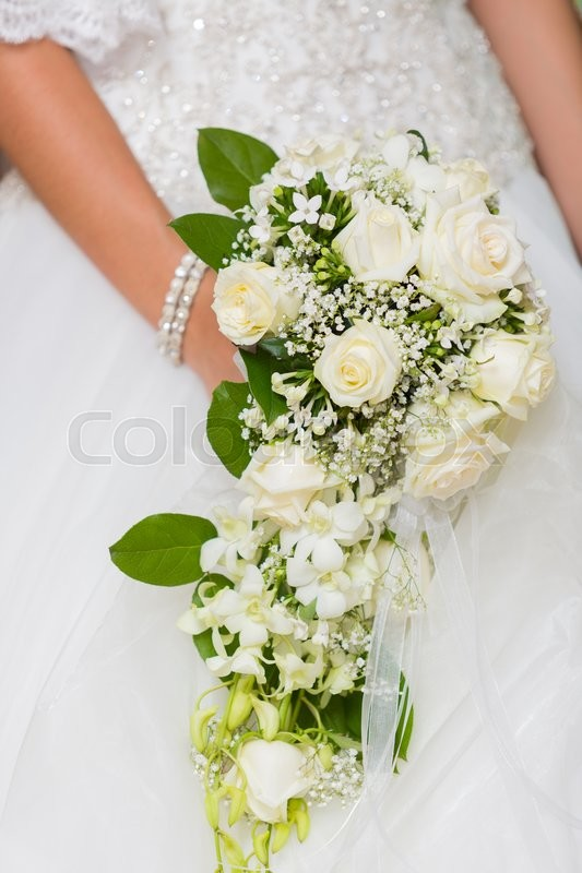 Stock image of 'Bride on her special day with her bouquet in hand'