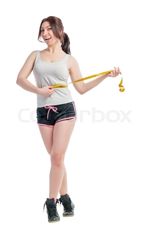 Stock image of 'Beautiful girl with centimeter at the waist thrown off weight'