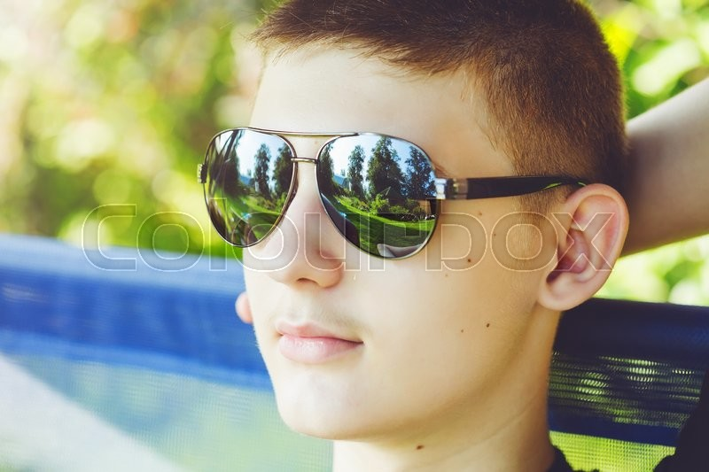Stock image of 'Closeup portrait of handsome man in stylish black sunglasses. Background toning for instagram filter.'