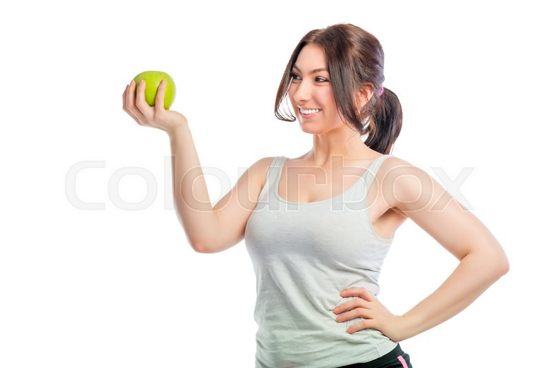 Stock image of 'Portrait of a girl with a green apple on a white background'