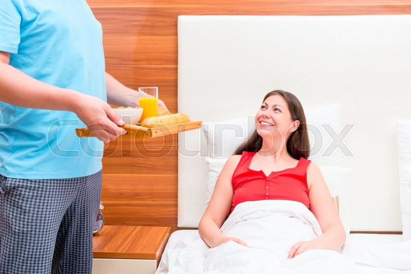 Stock image of 'Husband brought his wife breakfast in bed'