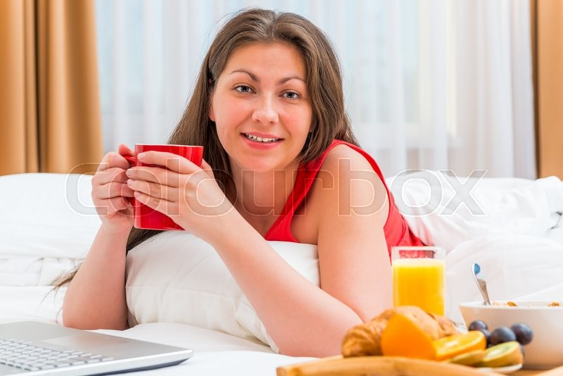 Stock image of 'Portrait of a beautiful girl with a cup of tea'