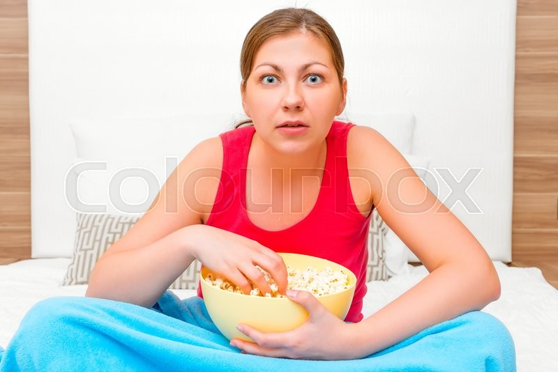 Stock image of 'Woman looking very interesting movie on TV'