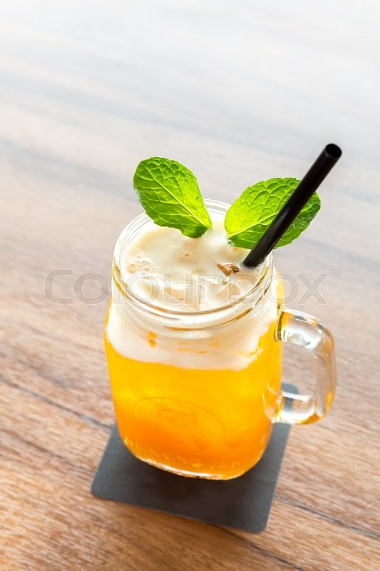 Stock image of 'glass of Ice Passionfruit tea with mint'