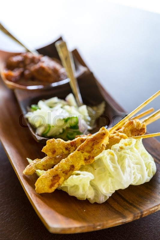 Stock image of 'Delicious Asian Cuisine Chicken Satay Curry'