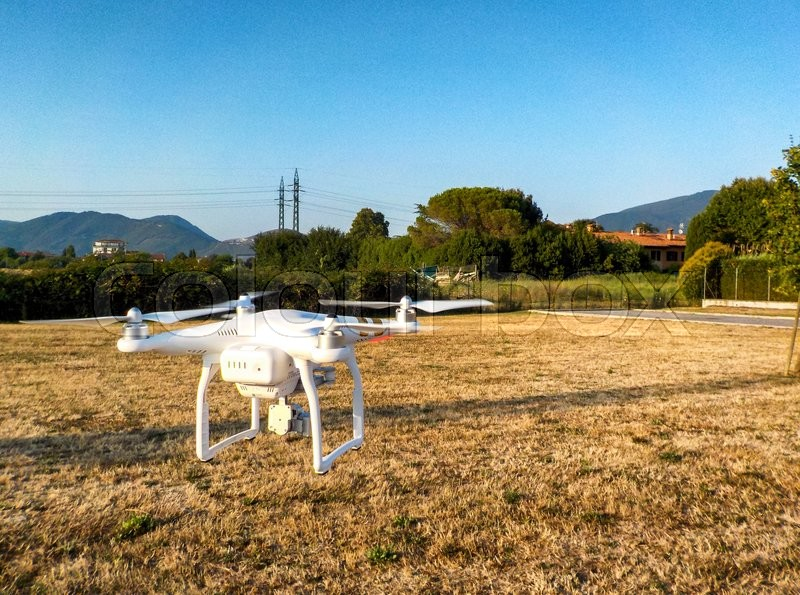 Stock image of 'PISA, ITALY - JULY 19, 2015: Drone Phantom 3 hovers in the air. DJI Phantom 3 is the latest drone from market leader DJI.'