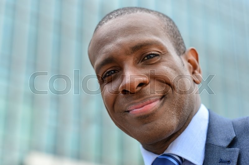 Stock image of 'Middle aged businessman posing at outdoors'