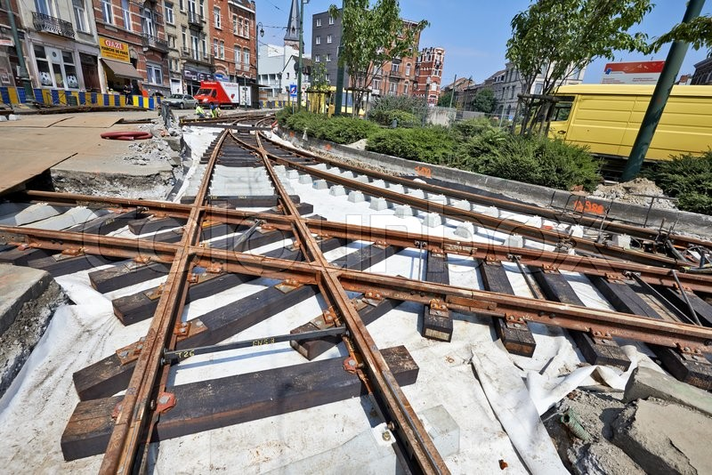 Editorial image of 'BRUSSELS, BELGIUM -16 JULY 2015: Some workers repair and replace rail trams in Brussels at Verboekhoven square in Schaerbeek.'