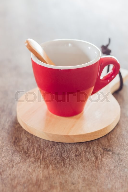 Stock image of 'Red mug with wooden plate, stock photo'