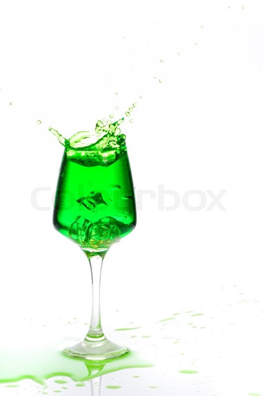 Stock image of 'Stemmed champagne glass with liquor splashing out, isolated on white background'