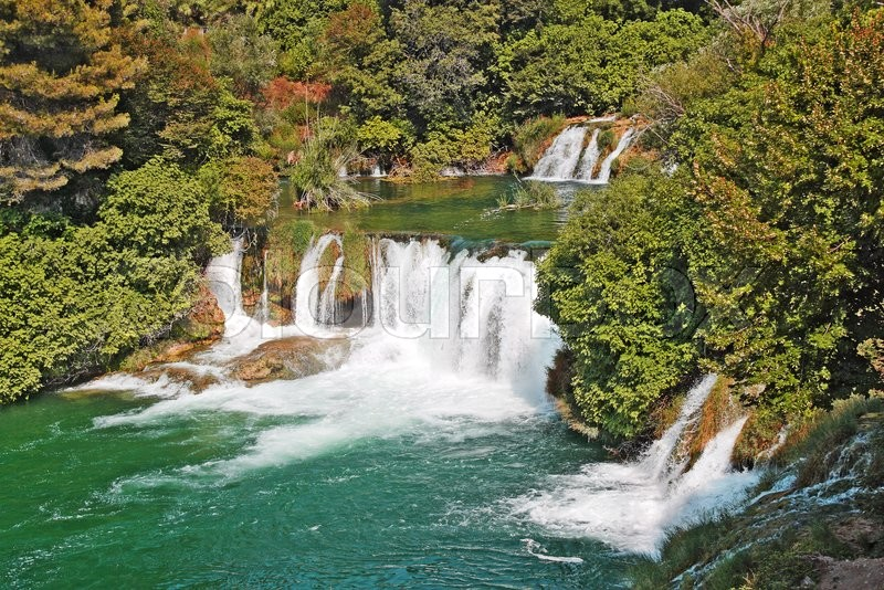 Stock image of 'Beautiful waterfalls of Krka turquoise green surrounded by lush vegetation'