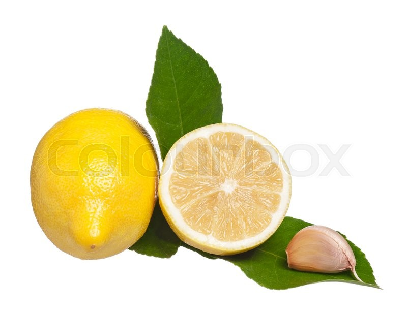 Stock image of 'Yellow lemon with green leaves and raw garlic isolated on a white background'