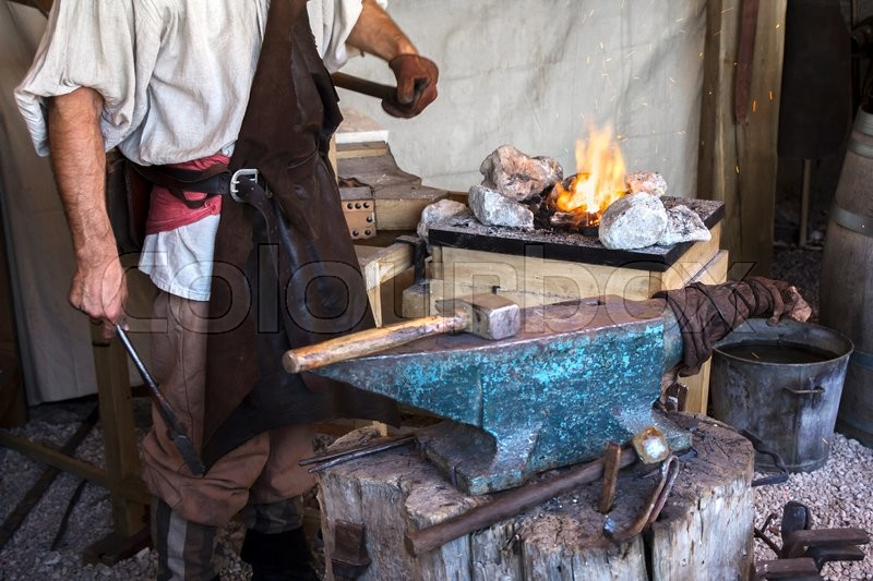 Stock image of 'Blacksmith vitange way of making articles of iron'