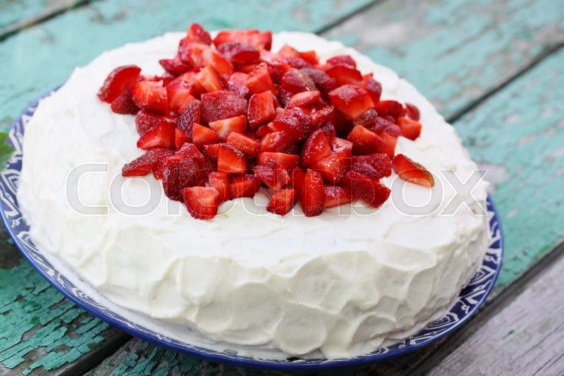 Stock image of 'cake with whipped cream, strawberries '