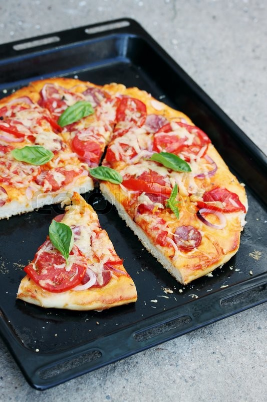 Stock image of 'homemade pizza on a black pan'