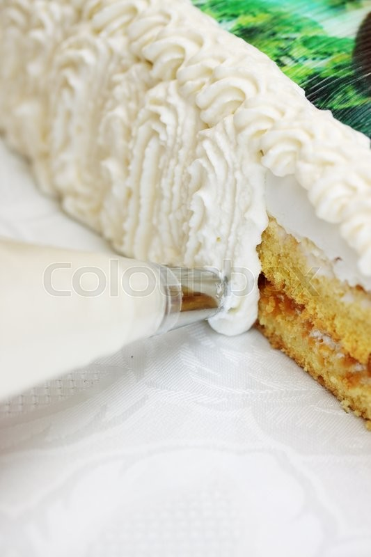 Stock image of 'decorate cream cake from a pastry bag'