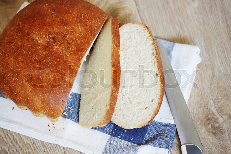 Stock image of 'Fresh home village bread on white towel'