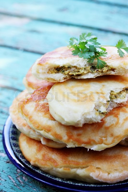 Stock image of 'Large meat pies cilantro and spices'