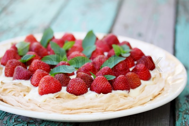 Stock image of ' Cake Pavlova. meringue with custard and strawberries'