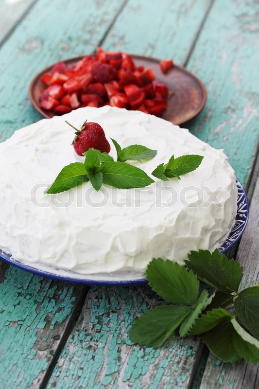 Stock image of 'cake with whipped cream, strawberries and mint'