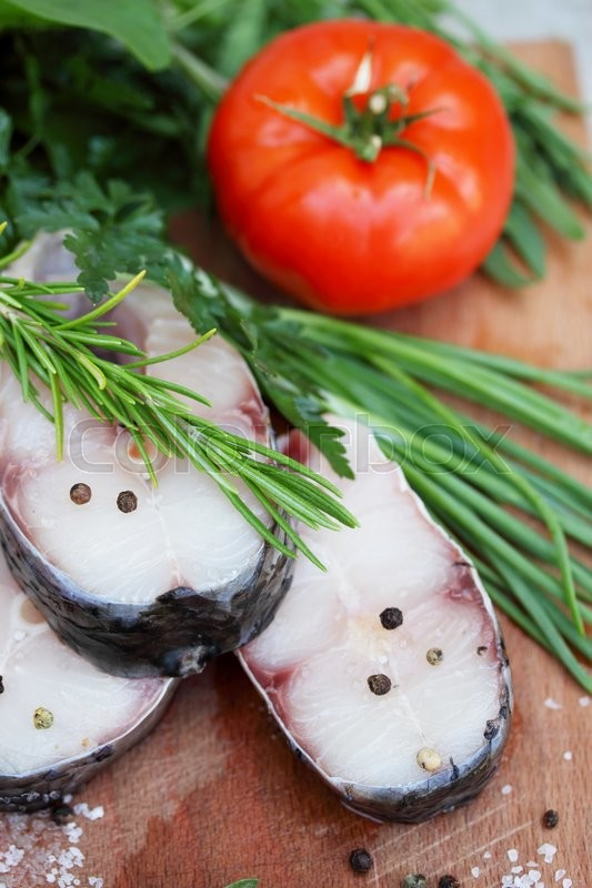 Stock image of ' Raw steaks fish carp with herbs and spices'