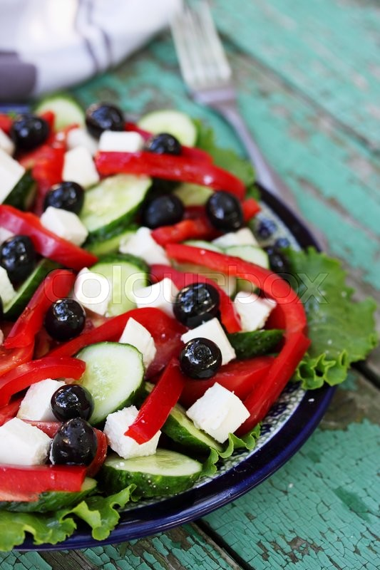 Stock image of 'Greek salad with feta cheese,  olives and vegetables'