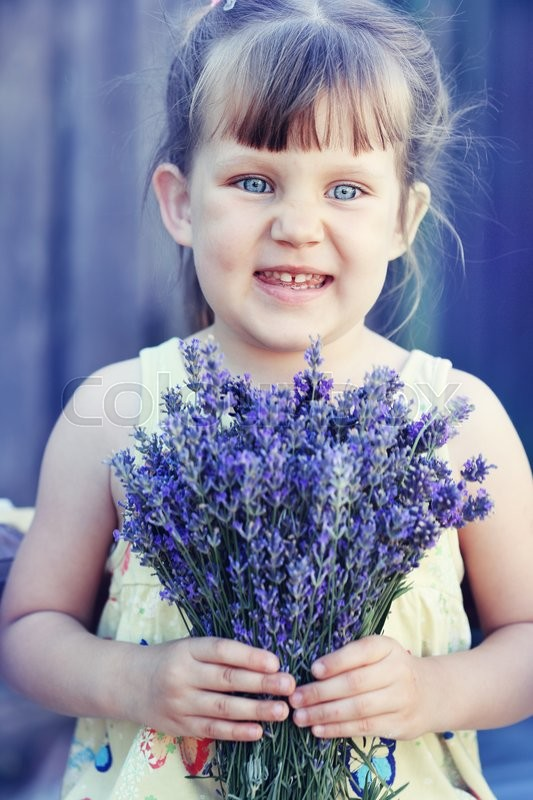 Stock image of 'girl holding a bouquet of lavender'