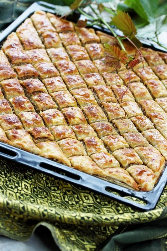 Stock image of 'Eastern sweets, baklava stuffed with nuts and honey'