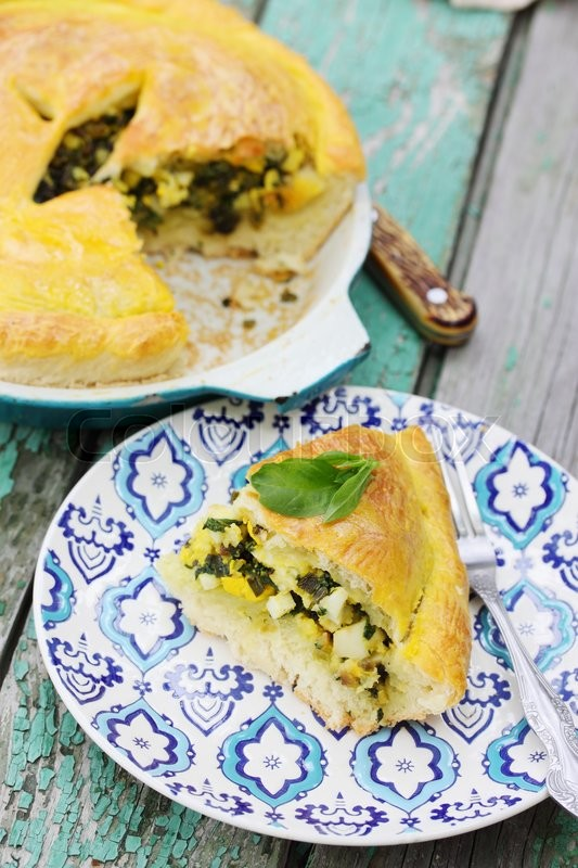 Stock image of 'Homemade pie with onion, spinach and eggs'