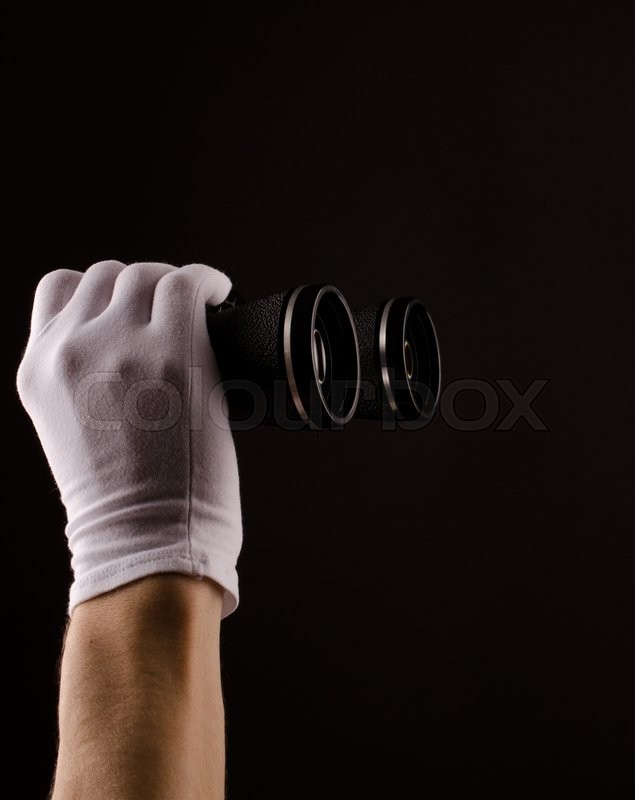 Stock image of 'Male hands with white gloves holding binoculars'
