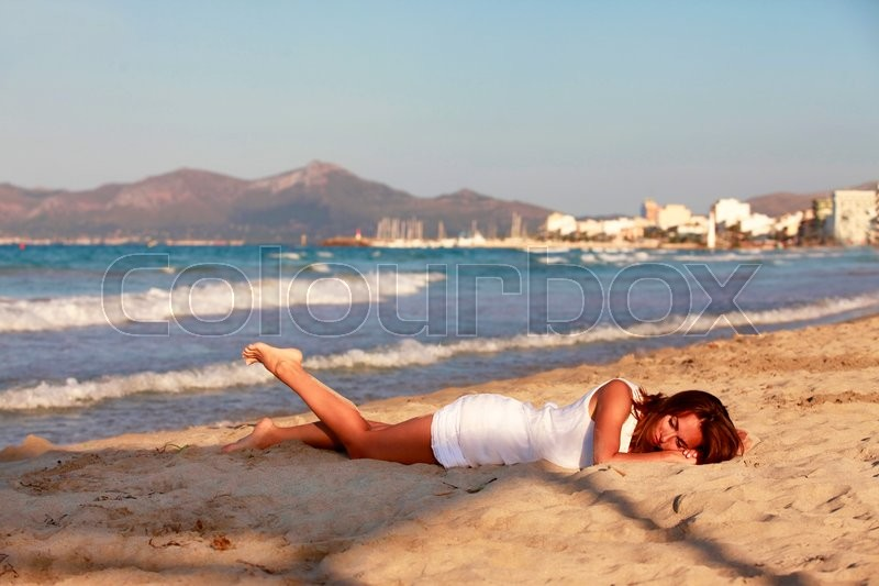 Stock image of 'The girl on coastline ocean admires nature'