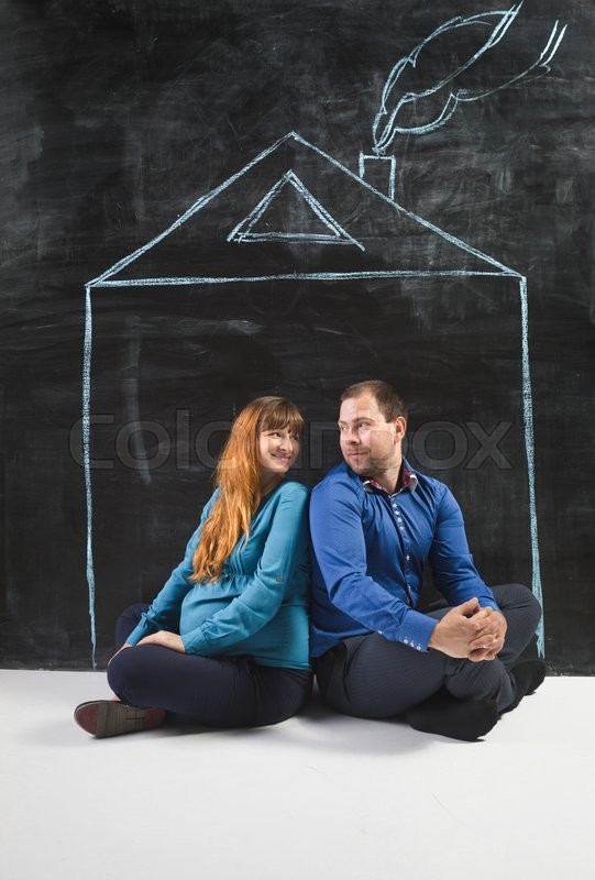 Stock image of 'Conceptual shot of happy young family posing in house drawn on chalkboard'