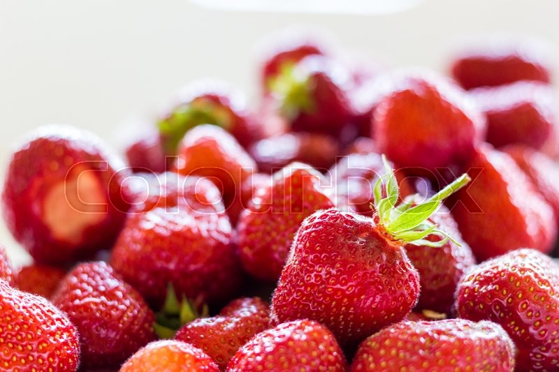 Stock image of 'A lot of fresh and red strawberries collected together'