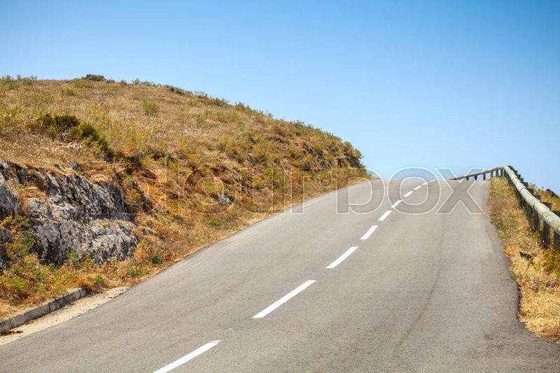 Stock image of 'Empty mountain asphalt road and blue sky'