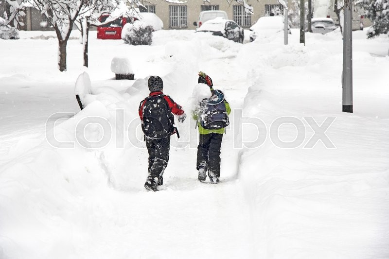Stock image of 'Two boys playing snowballs  in a park covered with deep snow  '