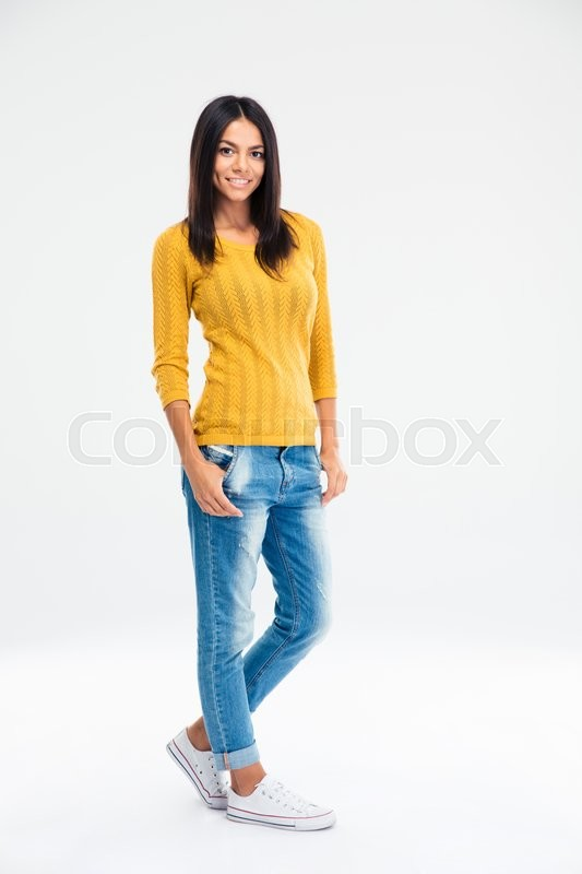 Stock image of 'Full length portrait of a happy beautiful woman posing isolated on a white background. Looking at camera'