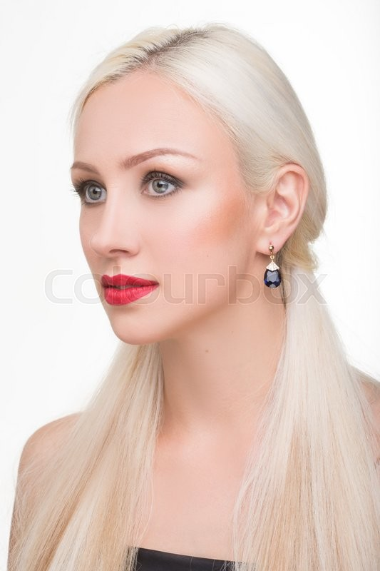 Stock image of 'beautiful girl with long white hair and earrings. fashionable photo. portrait. Fashion photo'