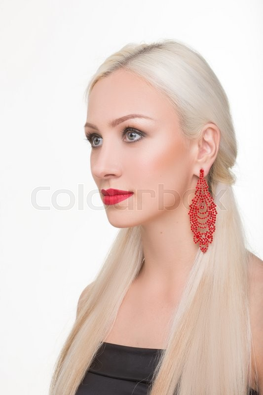 Stock image of 'beautiful girl with long white hair and red earrings. fashionable photo. portrait. Fashion photo'