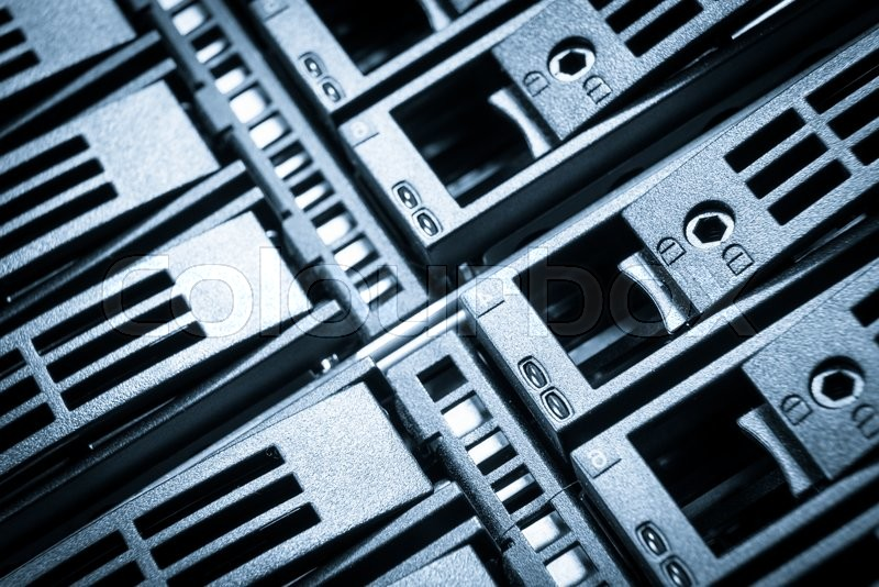 Stock image of 'close-up of hard drives in data center'