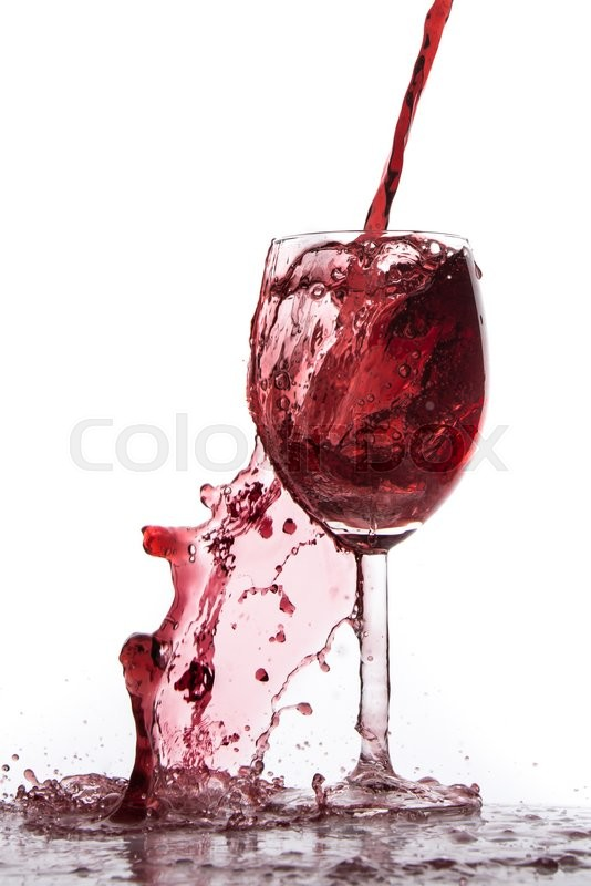 Stock image of 'pouring red wine in goblet, isolated on white'