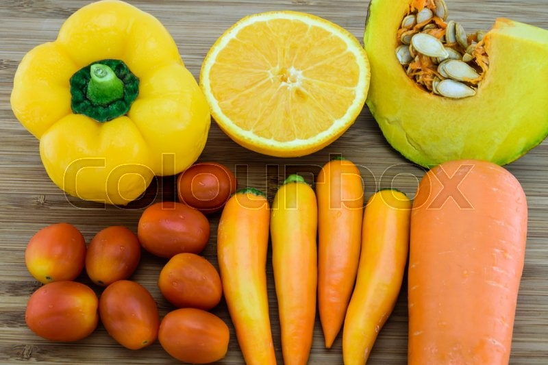 Variety of Orange color fruits and vegetables which are a good source of beta-carotene, stock photo