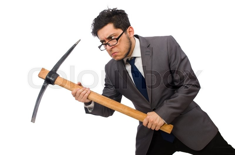 Stock image of 'Young businessman holding a tool isolated on white'