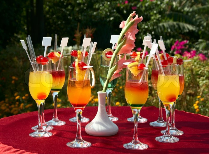Cocktails on the red table at outdoor party stock photo colourbox