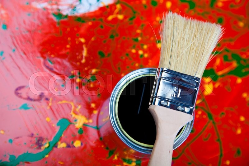 Paint buckets, paint and brush, bright colorful tone concept, stock photo