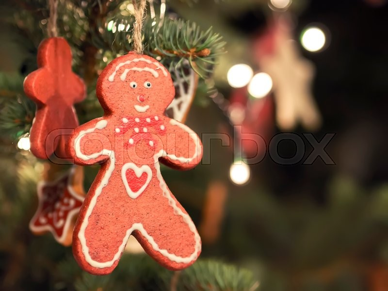 image of a gingerbread man as a decoration on a christmas market stock photo colourbox