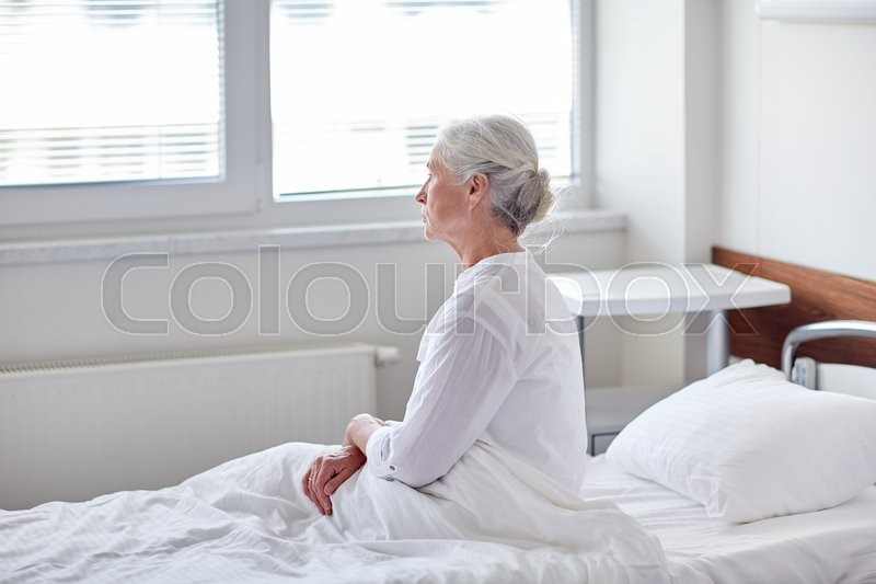 Medicine, age, health care and people concept - senior woman patient lying in bed at hospital ward, stock photo