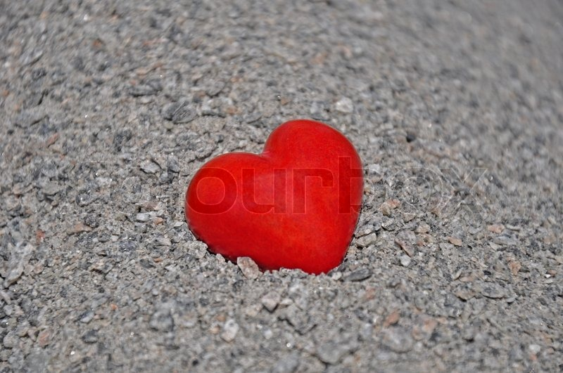 Red heart gray background red stone heart on a background of gray