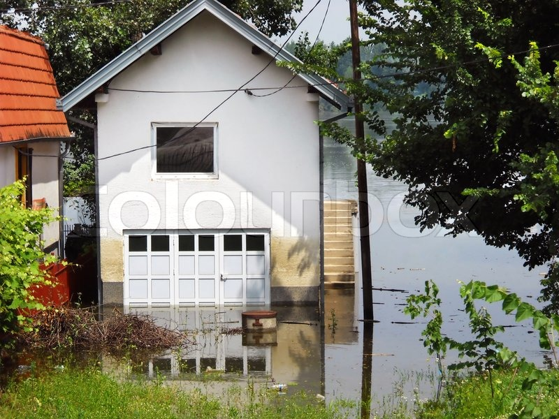 House Surrounded By Water In River During Spring Flood In