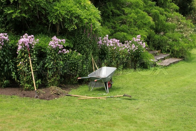 The gardener has a break in the wonderful garden in the summer in Ireland, stock photo