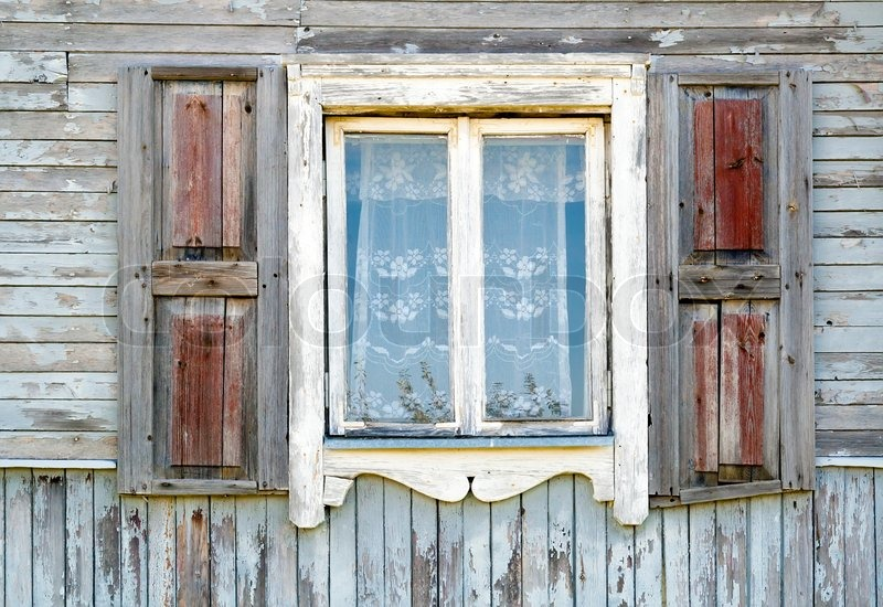 Old dirty white window in the old wooden house texture ...